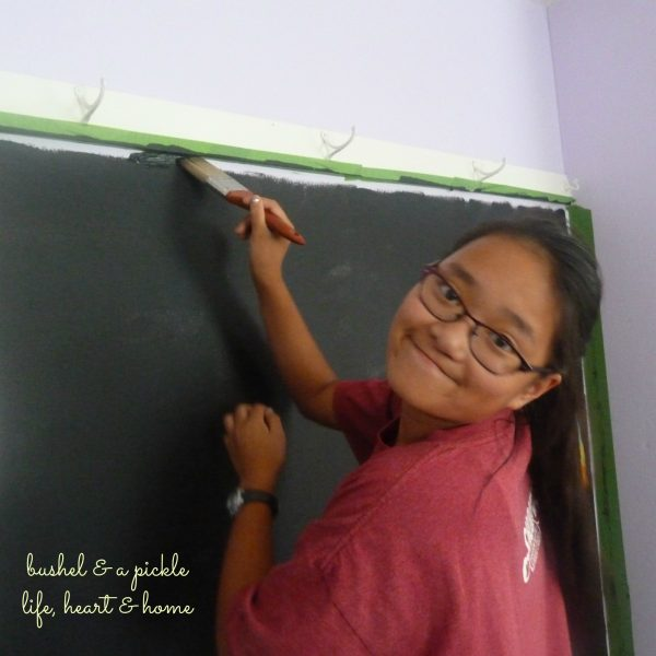 Meg painting black board