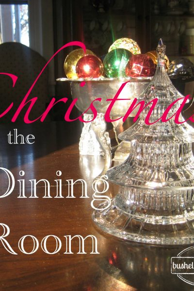 Simple yet elegant glass and silver decor with shiny Chritmas balls for the dining room table usong vintahe pieces