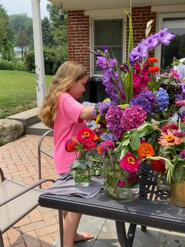 The gilrs can arrange all the flowers just as they like in a variety of vases