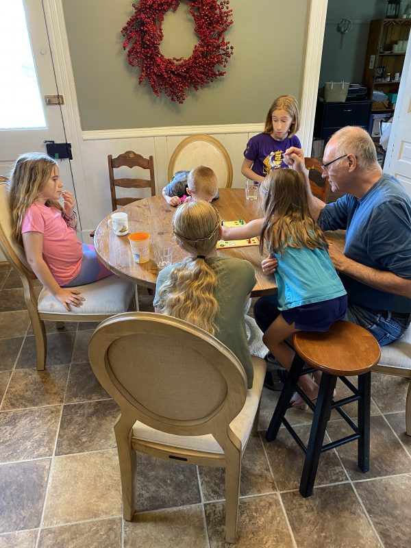 More games with Grandpa and grandkids at kitchen table