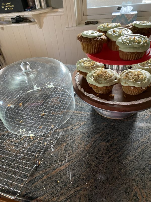 carrot cupcakes ,cooling rack and covered cake stand