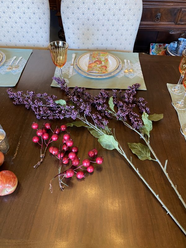 fall tablescape elements purple clusters and red berry faux stems