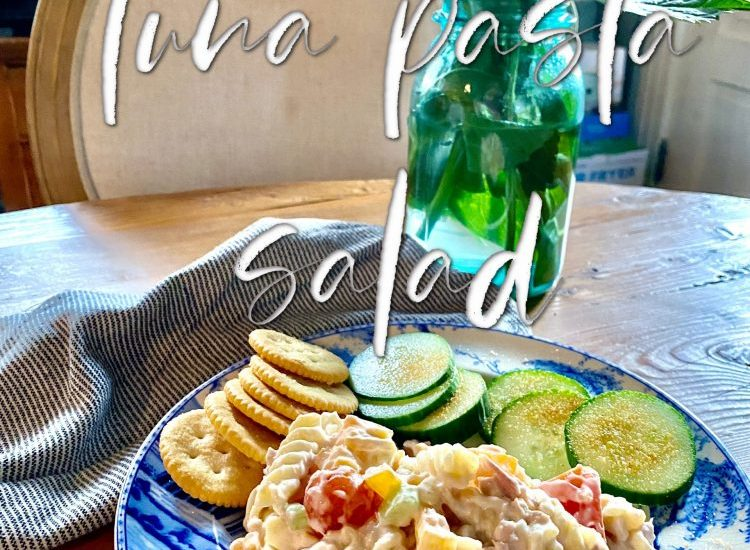 Tuna Pasta Salad served with cucumber slices and Rita crakers with zinnias in vlue Bell jar on the table