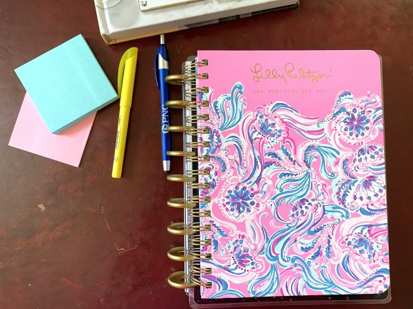 Lily Pulitzer Planner with Post it noters, pen and highlighter