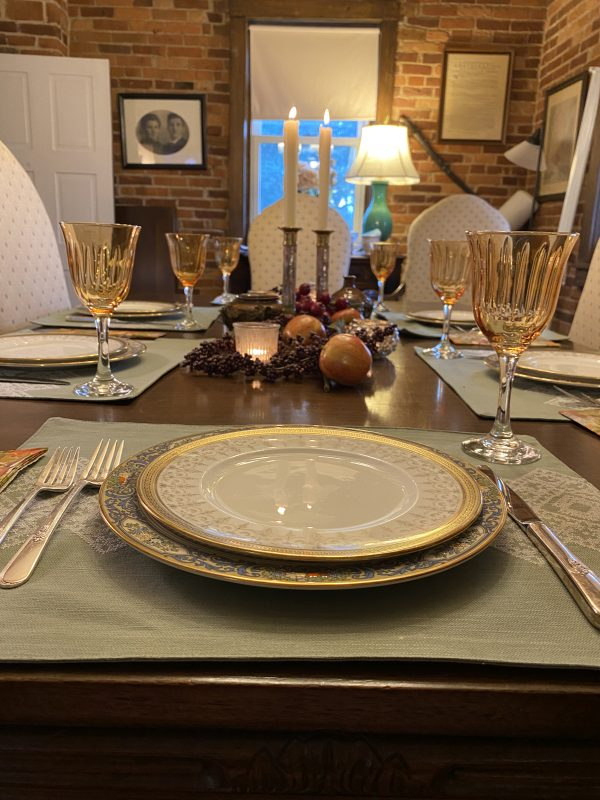 fall tablescape place setting with candle light
