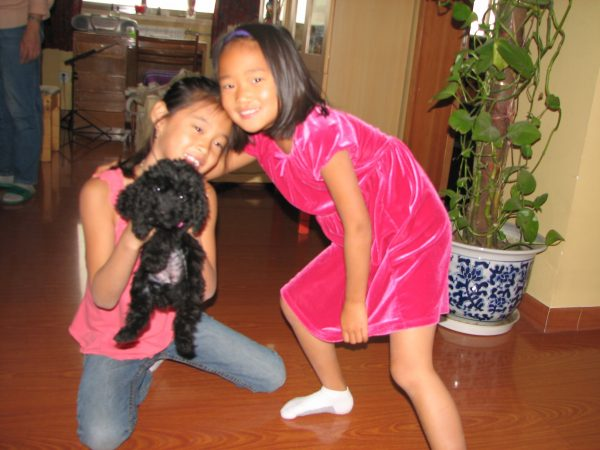 Amy and Meg holding baby Shadow, the 'black' dog