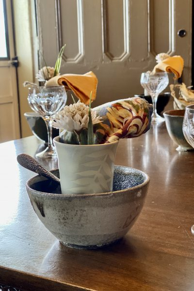 Place Setting with Handthrown Original Bowl, floral napkin and pottery cup