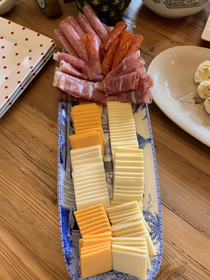 simple cheese and cold cuts on blue long platter